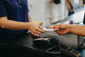 Woman paying a cashier