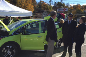 Electric vehicle enthusiasts at a drive electric event